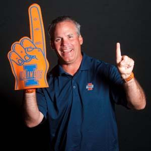 Darrell Hoemann/The News-Gazette Illinois football coach Tim Beckman shows his spirit for the upcoming season at Memorial Stadium in Champaign on Thursday, June 28, 2012.