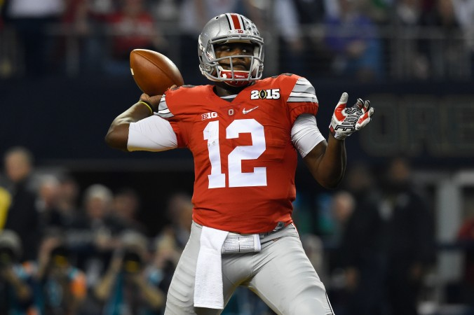 Jan 12, 2015; Arlington, TX, USA;Ohio State Buckeyes quarterback Cardale Jones (12) throws during the first quarter in the 2015 CFP National Championship Game at AT&T Stadium. Ohio State Buckeyes defeated Oregon Ducks 42-20. Mandatory Credit: Tommy Gilligan-USA TODAY Sports